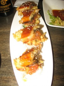 Some type of eel sushi roll