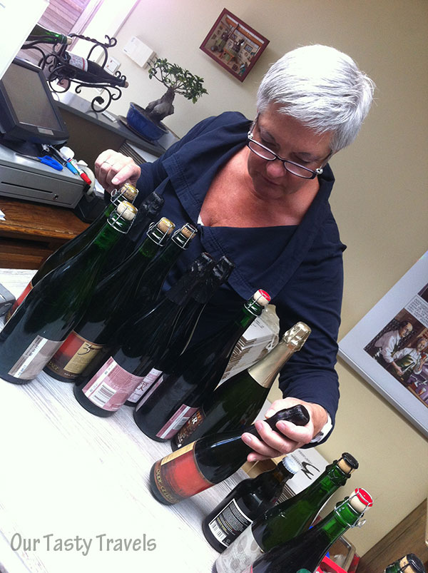 Lydie Debelder helping a customer with their special beer purchases.