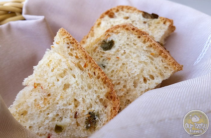 Assyrtico's homemade bread with local capers http://ourtastytravels.com/blog/eat-santorini-assyrtico-wine-restaurant-fira/ #food #travel #santorini #greece #ourtastytravels #ottmed14