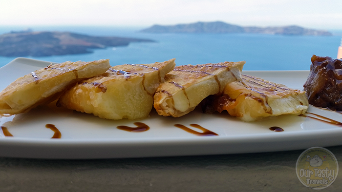 Assyrtico Saganaki http://ourtastytravels.com/blog/eat-santorini-assyrtico-wine-restaurant-fira/ #food #travel #santorini #greece #ourtastytravels #ottmed14