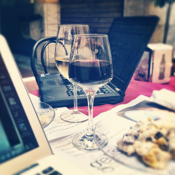 Working away with a glass of vino, the only way to write blog posts!