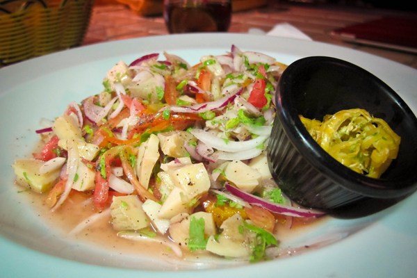 Horse conch ceviche at Hurricane's Ceviche Bar in Ambergris Caye, Belize http://ourtastytravels.com/blog/photo-of-the-week-horse-conch-ceviche-at-hurricanes-in-san-pedro-belize/ #ourtastytravels #cayetobelize