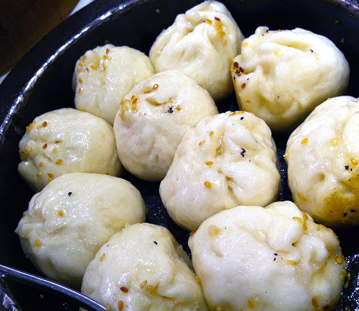 Crispy pork buns from Kao Chi in Taipei, Taiwan http://ourtastytravels.com/blog/obsession-asian-dumplings-favorite-picks/ #food #dumplings #ourtastytravels