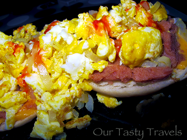Open-face Johnny Cake with Cheese Whiz, beans, eggs, onions, and Marie Sharp's hot sauce! http://ourtastytravels.com/recipes/belizean-cuisine-breakfast-johnny-cakes-belize/ #belize #ourtastytravels #cayetobelize