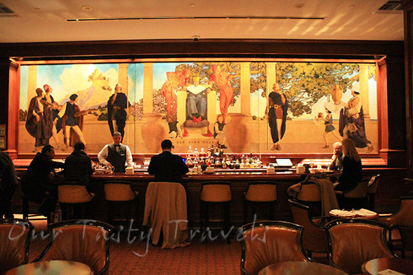 Giant mural is backdrop of bar at King Cole Bar at the St. Regis http://ourtastytravels.com/blog/st-regis-hotel-new-york-city-american-birthplace-of-the-bloody-mary-cocktail/ #ourtastytravels