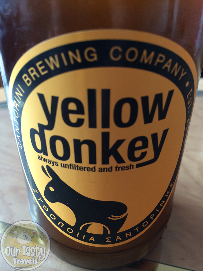 Santorini Brewing Company Yellow Donkey http://ourtastytravels.com/blog/craft-beer-santorini-greece/ #beer #ottmed14 #ourtastytravels